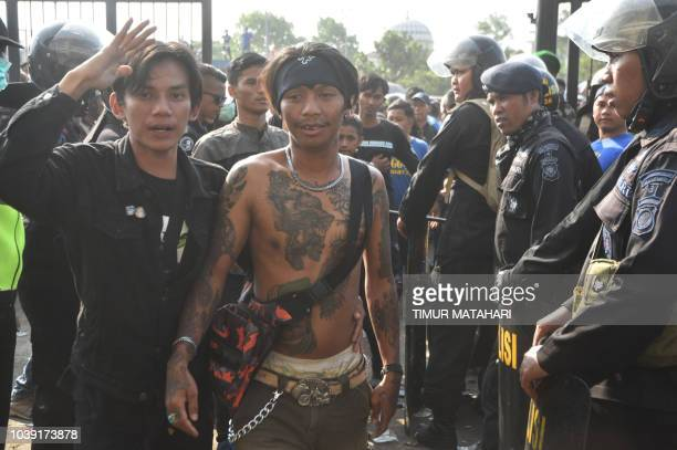 This picture taken in Bandung West Java on September 23 shows Indonesian policemen checking supporters of Bandung's football club 'Persib' as they...