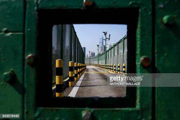 TOPSHOT This picture taken in Hong Kong on February 13 2017 shows the border fence with Shenzhen China / AFP PHOTO / Anthony WALLACE
