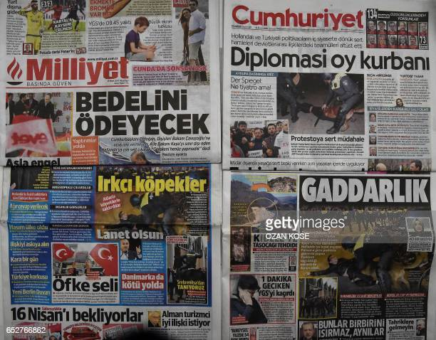 This picture taken in Istanbul on March 13 2017 shows the front pages of Turkish newspapers bearing headlines concerning diplomatic tensions between...