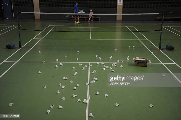 This picture taken in Jakarta on April 9 2013 shows shuttle cocks on a court as badminton players train at a venue Badmintoncrazy Indonesia is...