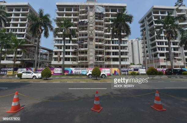 This picture taken in Jakarta on July 2 shows the old athletes villages at the Senayan sports complex being renovated, forty-seven days away from the...