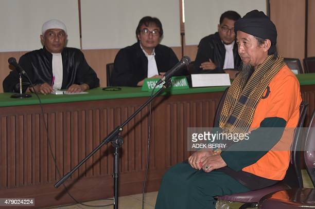This picture taken in Jakarta shows Indonesian Afief Abdul Madjid attending his trial at a court on June 29 2015 An Indonesian court on June 29...