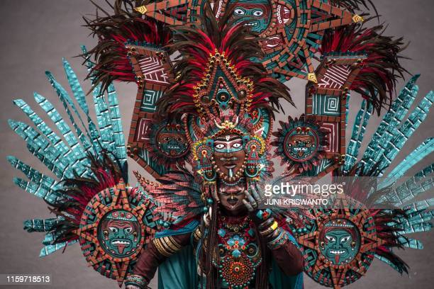TOPSHOT This picture taken in Jember on August 4 2019 shows an Indonesian model displaying during the Jember Fashion Carnaval in Jember