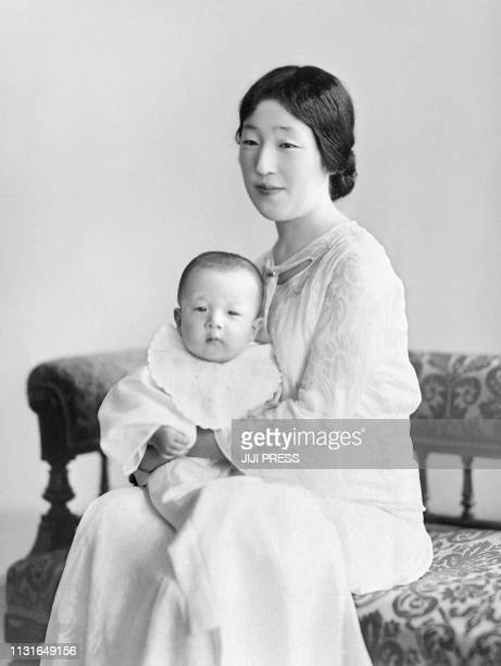 This picture taken in July 1934 shows sevenmonthold Emperor Akihito and his mother Empress Nagako / Japan OUT