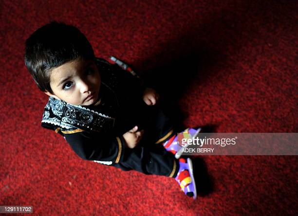 This picture taken in Kabul on October 12 2011 shows an Afghan child at a shelter run by women for Afghan women In the wartorn country Afghan women...