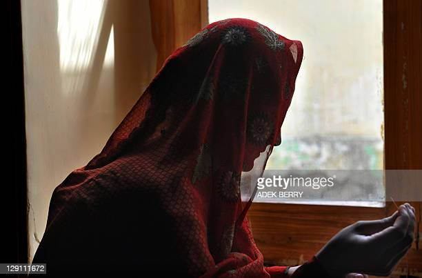 This picture taken in Kabul on October 12 2011 shows an Afghan woman making handcrafts at a shelter run by women for Afghan women In the wartorn...