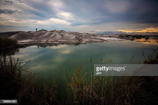 This picture taken in Kereng Pengi Pontianak in West Kalimantan province in Indonesia's Borneo Island on August 24 2013 shows an illegal gold mining...