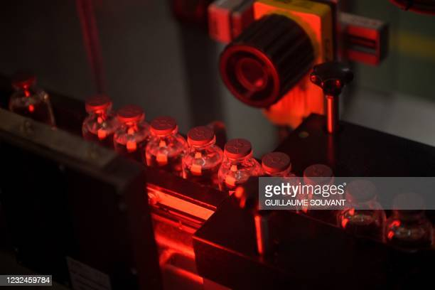This picture taken in Monts, central France, on April 22 shows vials of the Moderna Covid-19 disease vaccine at Recipharm plant. - Recipharm has been...