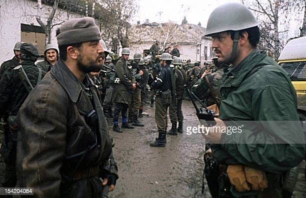 This picture taken in November 1991 in the Croatian town of Vukovar shows Yugoslav army captain Miroslav Radic listening to a report of a Serbian...