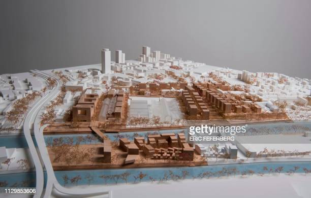 This picture taken in Paris on March 4 shows a view of the model of the Olympic Athletes Village of the Paris 2024 Olympic Games which is located...