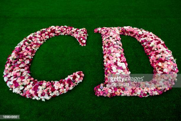 This picture taken in Paris on May 29 shows a flower logo of the French luxury brand Christian Dior at the Grand Palais in Paris two days before the...