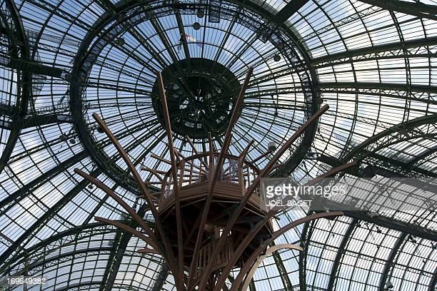 This picture taken in Paris on May 29 shows the Grand Palais' glass roof as it is transformed into a giant greenhouse two days before the opening of...