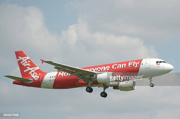 This picture taken in Tangerang on March 18 2013 shows Indonesia Air Asia plane preparing for landing over the SukarnoHatta airport in Tangerang AFP...