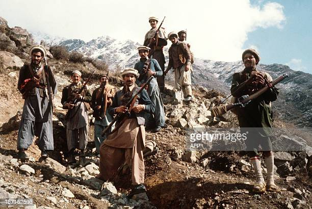 This picture taken in the early 80s shows the premier groups of the Afghan antiSoviet resistance fighters with their primitive arms in the eastern...