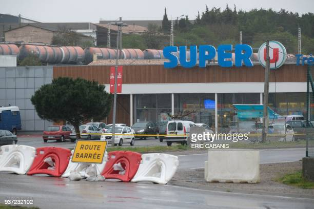 This picture taken in the town of Trebes southwestern France on March 24 2018 shows a view of the Super U supermarket where a man took hostages in a...