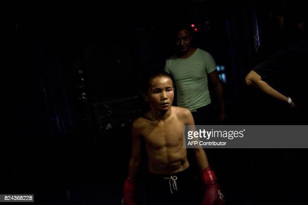 This picture taken June 2 2017 shows Abieamu preparing to fight in an underground fight club in Chengdu Abieamu is among the kids from the Tibetan...