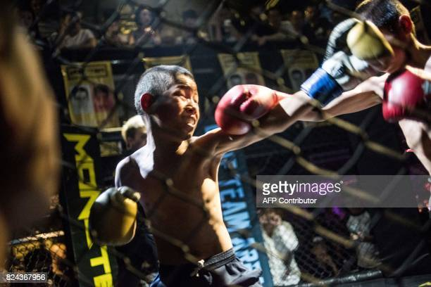 This picture taken June 2 2017 shows Jihushuojie and Abieamu fighting in an underground fight club in Chengdu Abieamu and Jihushuojie are among the...