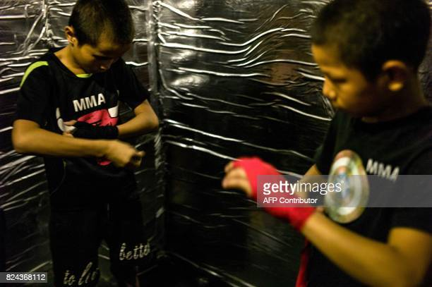 This picture taken June 2 2017 shows Jihushuojie and Abieamu preparing for a fight in an underground fight club in Chengdu Abieamu and Jihushuojie...