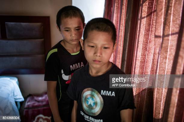 This picture taken June 2 2017 shows Jihushuojie and Abieamu posing in their hotel room before fighting at an underground fight club in Chengdu...