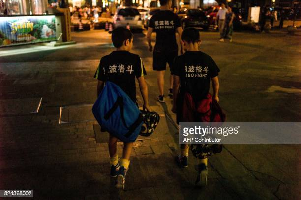 This picture taken June 2 2017 shows Jihushuojie and Abieamu walking to an underground fight club in Chengdu Abieamu and Jihushuojie are among the...