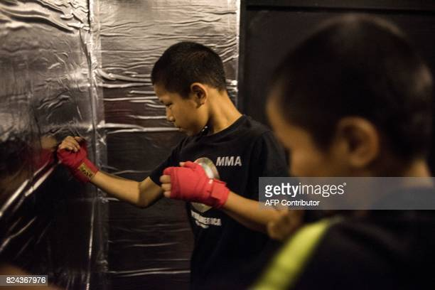This picture taken June 2 2017 shows Jihushuojie and Abieamu warming up before fighting in an underground fight club in Chengdu Abieamu and...