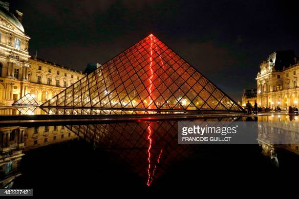 This picture taken late on April 2 2014 shows 'Sous le plus grand chapiteau du monde' an artistic performance by French artist Claude Leveque at the...