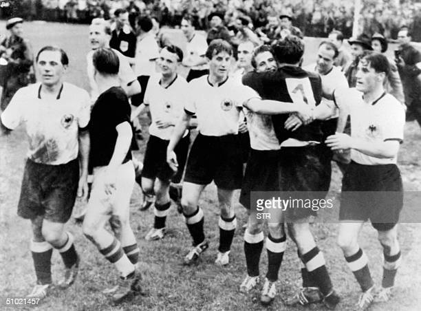 This picture taken on 04 July 1954 shows the German team congratulating each other after winning the 1954 World Cup against Hungary in Bern By...