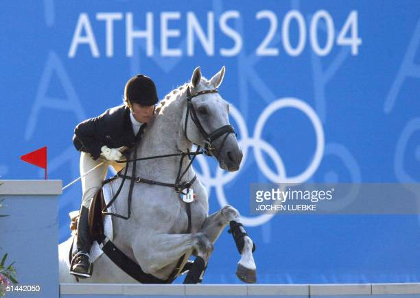 "- This picture taken on 18 August 2004 shows German eventing rider Bettina Hoy jumping with her horse ""Ringwood Cockatoo"" over a fence at the..."