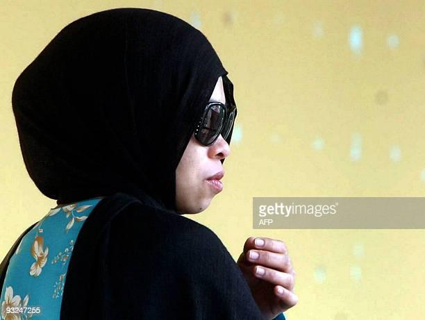 This picture taken on 20 July 2009 shows Singaporean Muslim model Kartika Sari Dewi Shukarno looking on at the Sharia High Court in Kuantan Pahang...