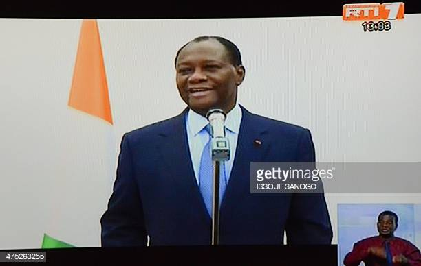 This picture taken on a television screen in Abidjan on February 27 2014 shows Ivorian president Alassane Ouattara making an announcement during a...