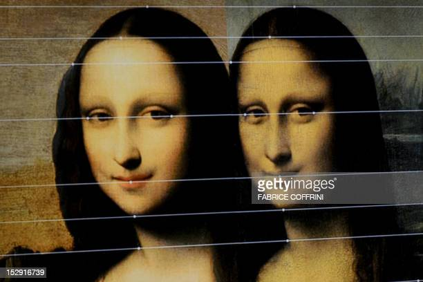 This picture taken on a TV screen on September 27 2012 in Geneva shows comparison lines between the Isleworth Mona Lisa and the Louvre's Mona Lisa...