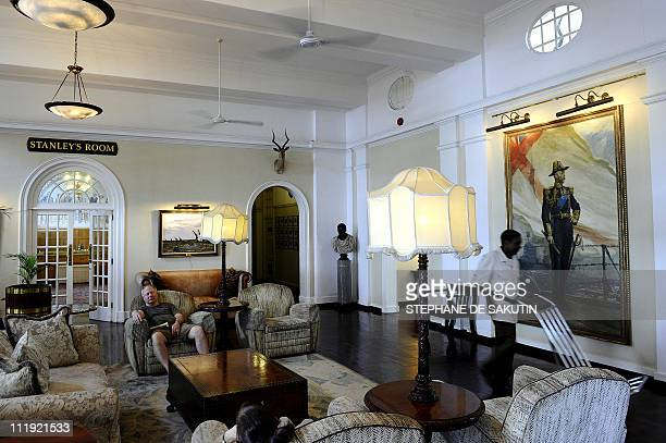 This picture taken on April 1 2011 shows a guest resting in the lobby of the Victoria Falls Hotel in Victoria Falls Zimbabwe Zimbabwe's tourism...