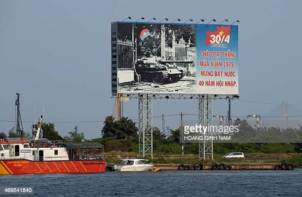 This picture taken on April 10 2015 shows a large billboard featuring the 40th anniversary of the communist North Vietnam's victory over the South...