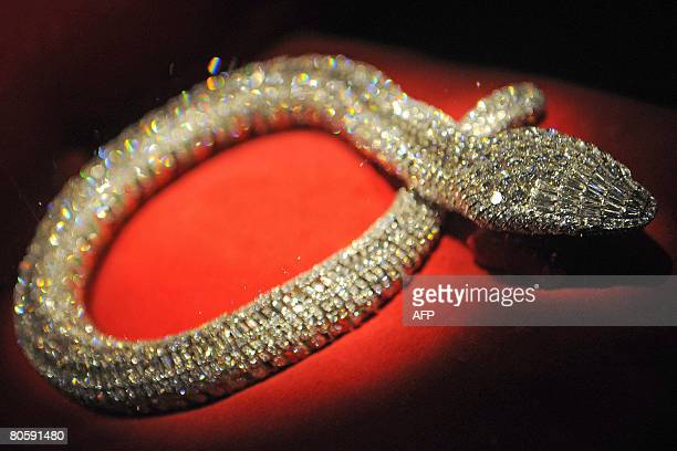 this picture taken on April 10 in Antwerp shows shows a snake necklace worn by Maria Felix a Mexican diva displayed at 'Diamond Divas' exhibition in...