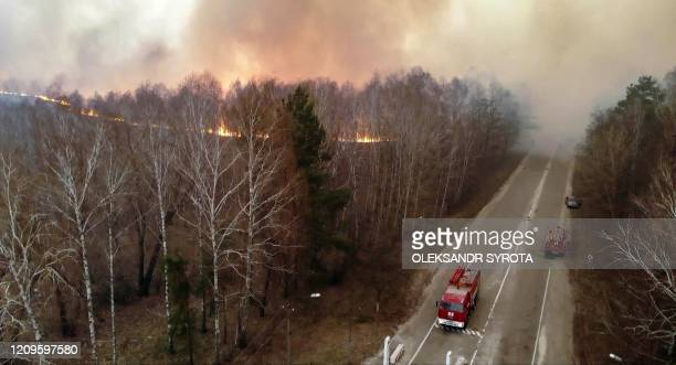 This picture taken on April 10 shows a forest fire burning at a 30kilometer Chernobyl exclusion zone in Ukraine not far from the nuclear power plant...