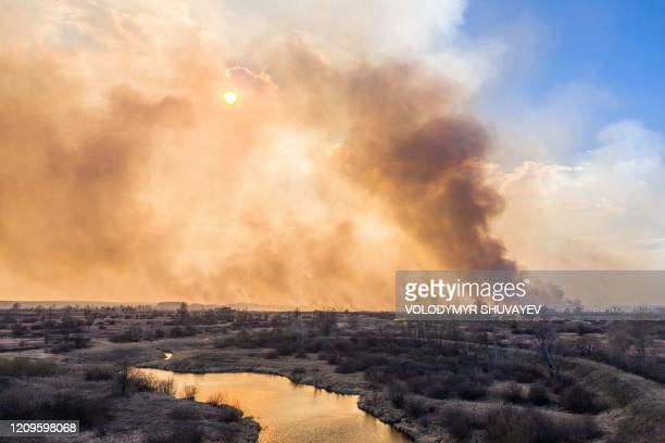 TOPSHOT This picture taken on April 10 shows a forest fire burning at a 30kilometer Chernobyl exclusion zone in Ukraine not far from the nuclear...