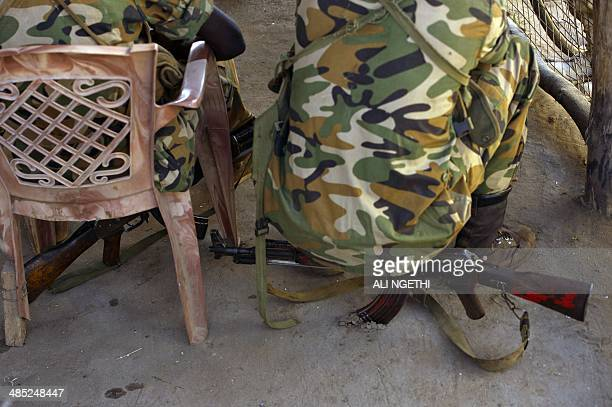 This picture taken on April 11 2014 shows SPLA soldiers resting inTerekeka At least 14 people were wounded in South Sudan on April 17 2014 after...
