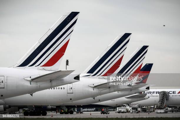 This picture taken on April 11 2018 shows Air France planes at Paris Charles de Gaulle Airport in Roissy north of Paris