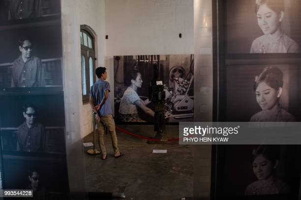 This picture taken on April 12 2018 shows a visitor view vintage film projector displayed at the Myanmar film heritage exhibition at the historic...