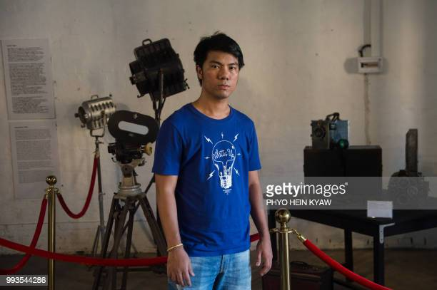 This picture taken on April 12 2018 shows contemporary Myanmar filmmaker Maung Okkar founder of the Save the Myanmar Film poses before vintage camera...