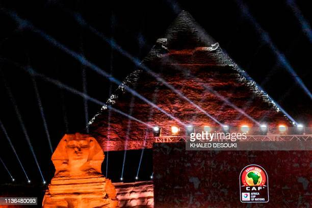 This picture taken on April 12 2019 prior to the 2019 CAF African Cup of Nations draw shows a view of the draw venue with the Pyramid of Khafre and...