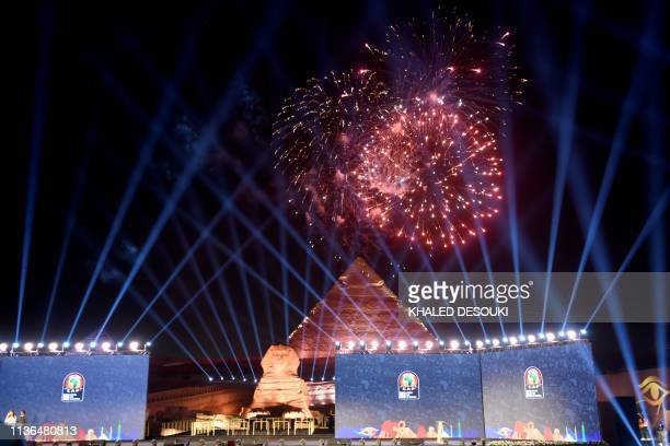 This picture taken on April 12 2019 prior to the 2019 CAF African Cup of Nations draw shows fireworks above the Pyramid of Khafre and the Sphinx at...