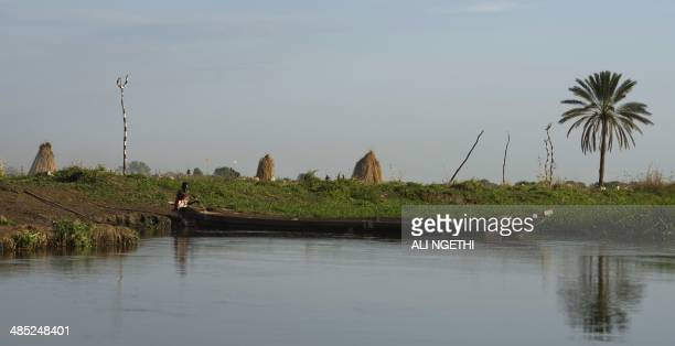 This picture taken on April 13 2014 shows Mundari fishermen on a canoe along the river Nile on April 13 2014 near Terekeka Conflict in South Sudan...
