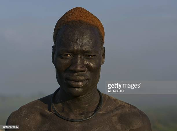 This picture taken on April 13 2014 shows the portrait of a Mundari youth wrestler on April 13 2014 near Terekeka Conflict in South Sudan has...
