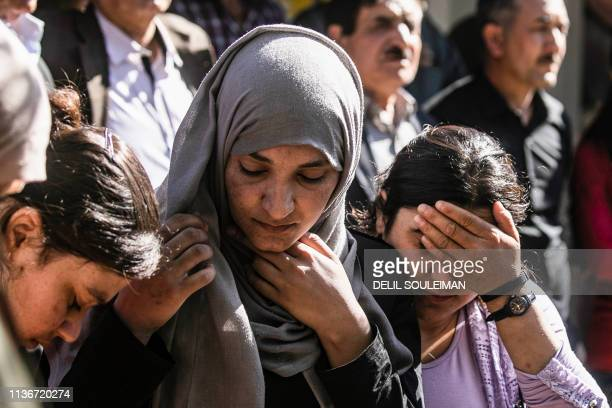 This picture taken on April 13, 2019 at the Syrian Kurdish-run group Yazidi House's headquarters in the Syrian Yazidi village of Qizlajokh, about 35...