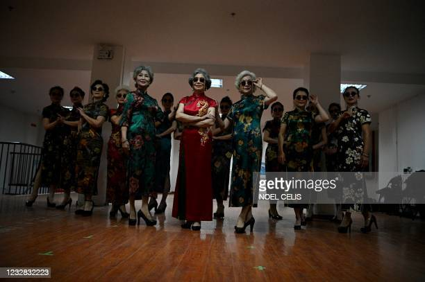 """This picture taken on April 14, 2021 shows members of the """"Fashion Grandmas"""" dressed in traditional costumes during a rehearsal for a performance on..."""