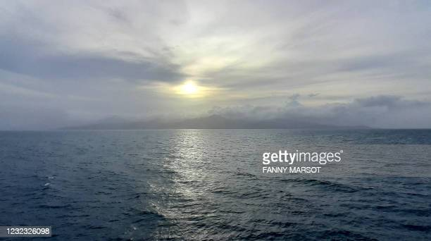 This picture taken on April 14 from the the Floreal class French frigate Ventose shows the island of Saint Vincent and the Grenadines as the frigate...