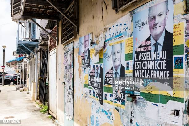 This picture taken on April 14 shows French candidate to the 2017 presidential elections François Asselineau's electoral posters the only ones...