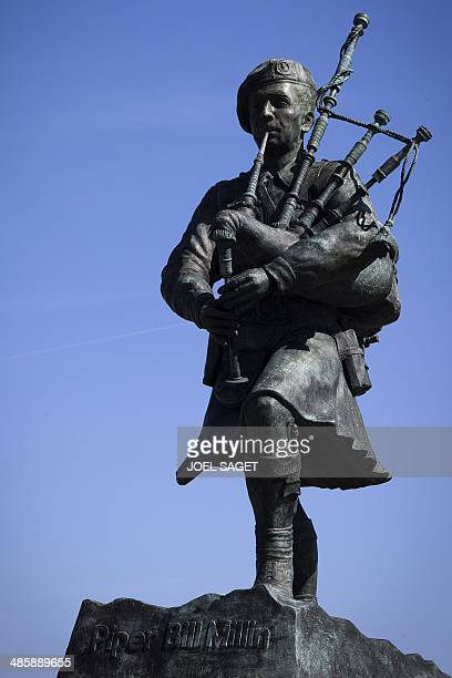 This picture taken on April 15 2014 shows the statue of Bill Millin best known as Piper Bill in Ouistreham northern France Bill Millin was Scotland...