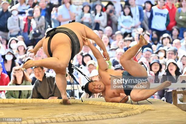 """This picture taken on April 15, 2019 shows sumo wrestlers taking part in a """"honozumo,"""" a ceremonial sumo exhibition, on the grounds of Yasukuni..."""
